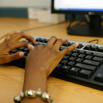 Wits student typing on a keyboard