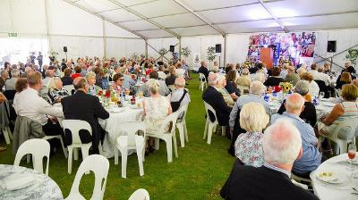 Guests at Founders' Tea 2017 in the marquee on the Gavin Relly Green