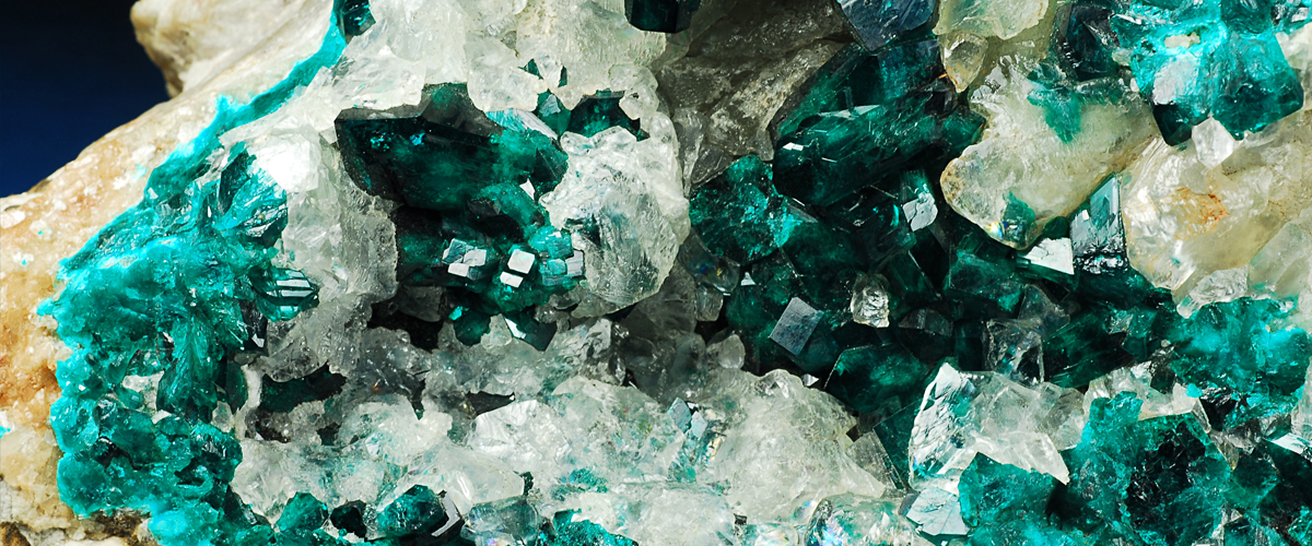 Mineral specimen of Dioptase surrounded by calcite from Guchab, Namibia. Specimen is housed in the Bleloch Museum, Geosciences Building. Photograph courtesy Professor Bruce Cairncross
