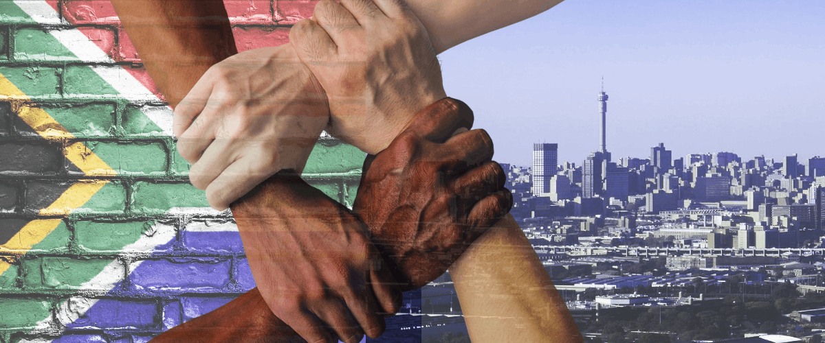 hands linking with city in background