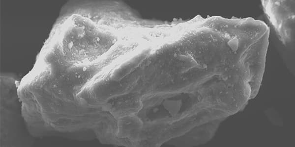 SEM image of quartz grains from the Gibson Bay sand quarry near the Vaal River, to determine whether the grains were transported by wind or water.