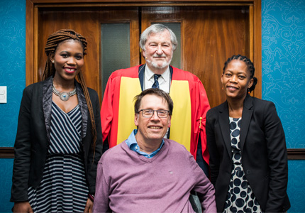 Prof. Eddie Webster flanked by former students.Top row (l-r): Nonkululeko Mabaso (masters student) and Dr Sarah Mosoetsa (Director: National Institute for the Humanities and Social Sciences) and Dr Karl von Holdt (Director: SWOP)