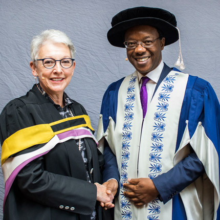 Justice Carole Lewis congratualated on her Gold Medal by Professor Tawana Kupe, Deputy Vice-Chancellor: Advancement