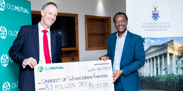 Iain Williamson, Finance Director and Interim CEO of Old Mutual Emerging Markets, handed over the cheque to Professor Tawana Kupe, Deputy Vice-Chancellor: Advancement, Human Resources and Transformation