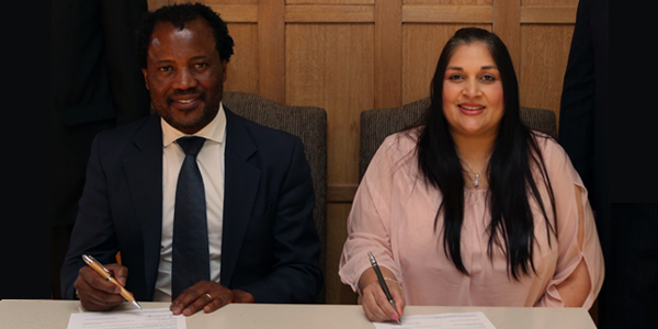 Professor Zeblon Vilakazi, Deputy Vice Chancellor at Wits University, sits together with Raakshani Sing, Executive Manager at CHIETA during the signing ceremony of Africa's first Energy Leadership Centre (ELC).