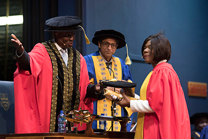 Advocate Thuli Madonsela receives her honorary doctorate in law from Wits Chancellor Dikgang Moseneke.