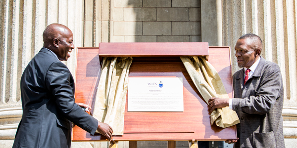 Wits Chancellor Justice Dikgang Moseneke and Dini Sobukwe, Robert Sobukwe's son unveiling a plaque of the renaming of Central Block to Robert Sobukwe Block