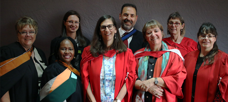 (Front from left) Janet Zambri, Thuli Dhlamini, Professor Karin Brodie (Head of the Wits School of Education), DrLaura Dison (PGDiPE(HE) Co-coordinator) and Jacqueline De Matos Ala. (Back from left)Agata Macgregor, David Merand and Estelle Trengove.