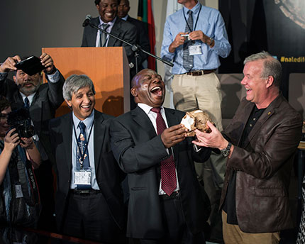 Professor Lee Berger shares a laugh with Deputy President Cyril Ramaphosa at the Rising Star launch