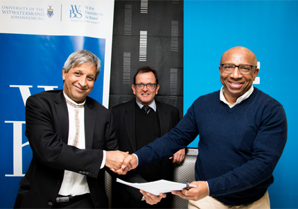 Professors Adam Habib, Vice-Chancellor at Wits, and Steve Bluen, Head of the Wits Business School, with Telkom CEO, Sipho Maseko