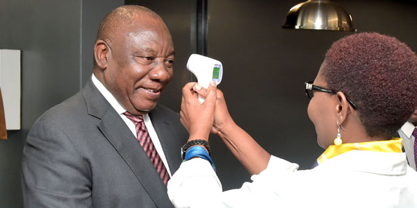 President Cyril Ramaphosa's temperature being tested during the COVID-19 pandemic ©GovernmentZA/flickr
