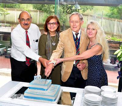 Pictured left to right cutting a cake are Prof. Charles Feldman (co-chair), Prof. Ames Dhai (co-chair), Prof. Peter Cleaton-Jones (chair) and Prof. Angela Woodiwiss (co-chair)