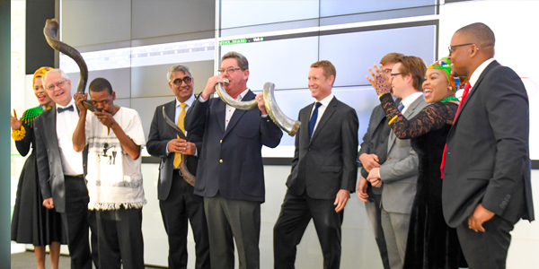 Wits and Absa participate in the JSE tradition of blowing kudu horns, symbolising the milestone listing