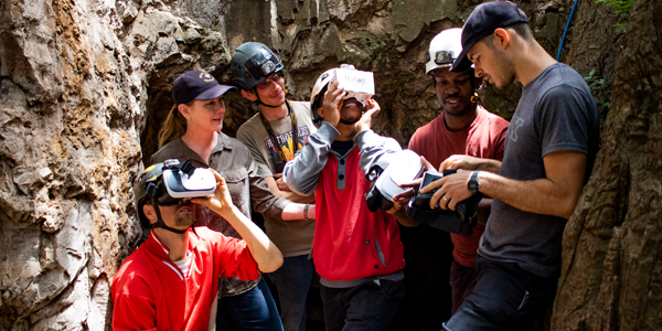 The exploration team of the Rising Star expedition experiences the Dinaledi VR for the first time.
