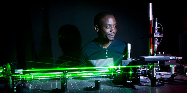 PhD student Nkosi Bhebhe works on an experiment in the Structured Light Laboratory at Wits University: Credit: Wits University.