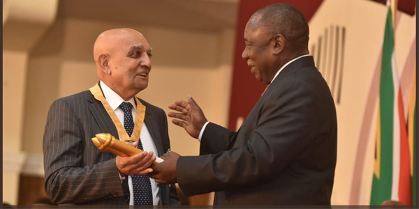President Cyril Ramaphosa bestowing a National Order on Professor Yosuf Veriava ( Photo credit: @PresidencyZA)