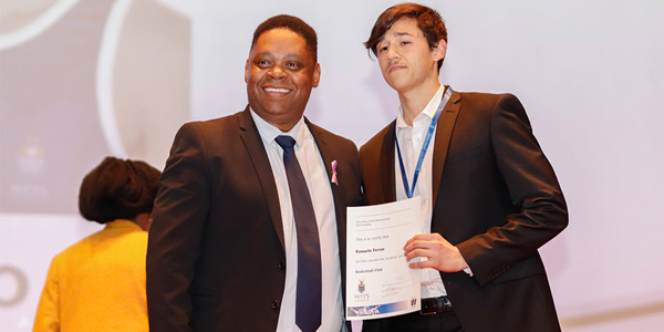Jerome-September, Dean of Student Affairs and electrical engineering student and athlete, Romario Ferrao at the 2019 Wits Sports Awards.