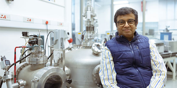 Professor Somnath Bhattacharyya next to the vapour deposition chamber that is used to produce diamonds in the lab.